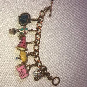 Juicy Couture gold charm bracelet and charms